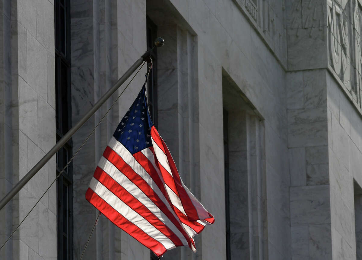 An American flag is flown outside James T. Foley Federal Courthouse on Thursday, Jan. 10, 2019, on Broadway in Albany, N.Y. (Will Waldron/Times Union)