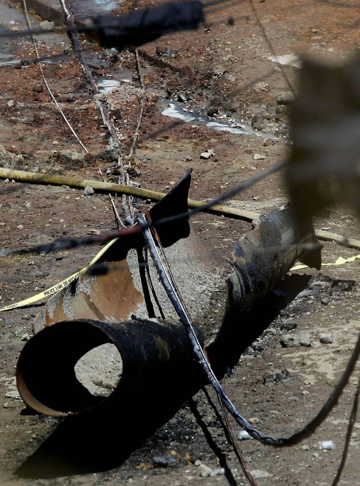 A piece of the large high pressure natural gas line, lies in the middle of the street covered with police tape, near the blast site on Friday Sept. 10, 2010, in which an explosion and fire leveled the surrounding neighborhood the night before in San Bruno, Calif.