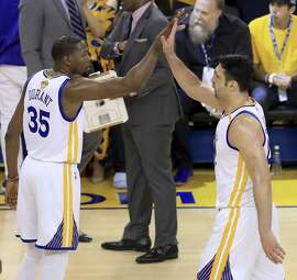 Kevin Durant and Zaza Pachulia work together for the Warriors in the 2017 NBA Finals at Oracle Arena.