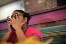Sakeya Cooks shows signs of exasperation Thursday as she talks about living without a paycheck while furloughed from her job at the IRS in Kansas City, Mo.