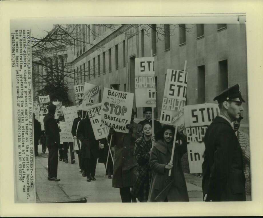 Picketers marching at the Justice Department in Washington to protest the racial situation in Selma, Ala. Photo: Associated Press / Houston Chronicle