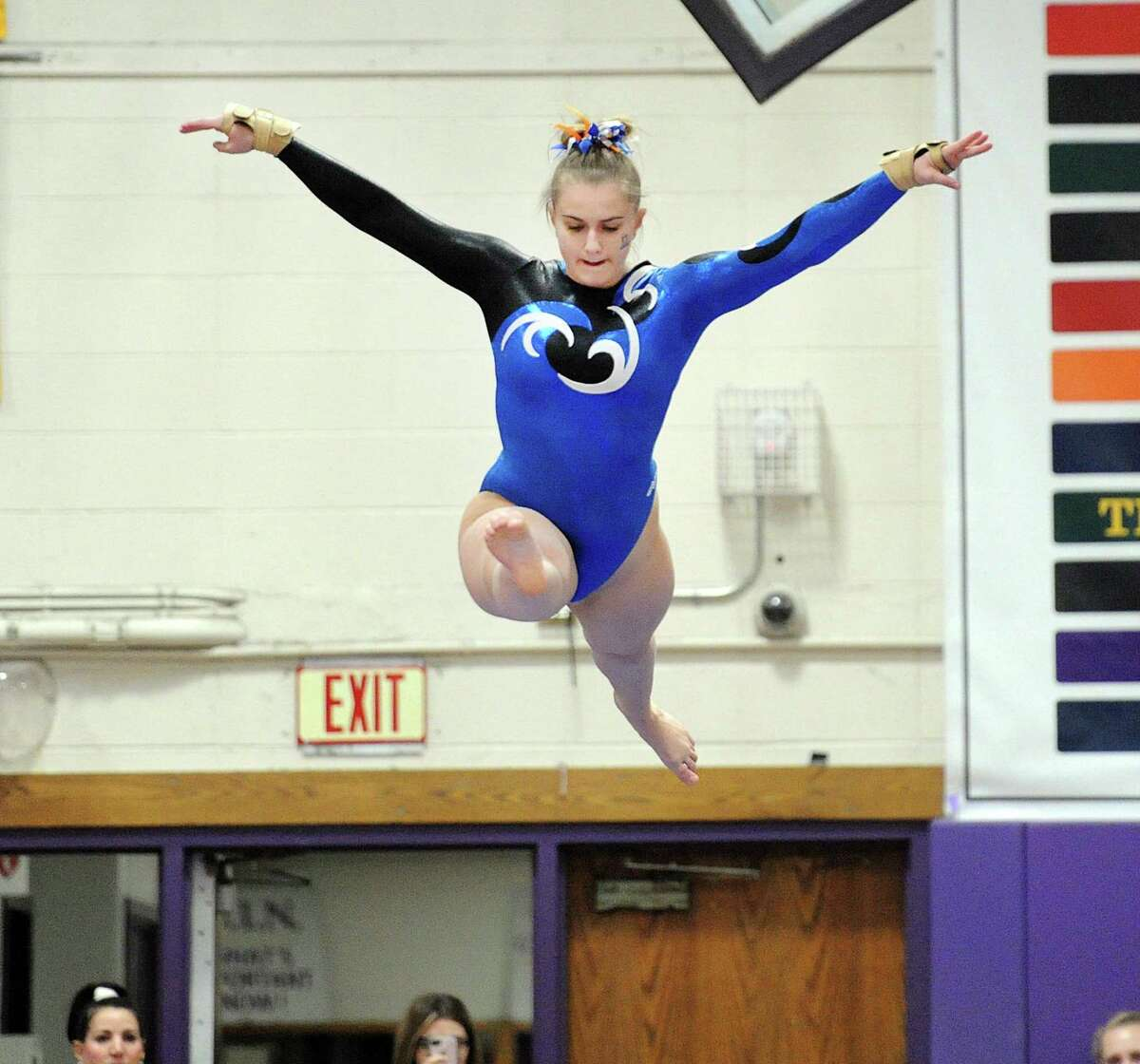 Darien's Nicole Carlo, shown in last season's FCIAC championship, took second place on the beam against Greenwich on Jan. 12.
