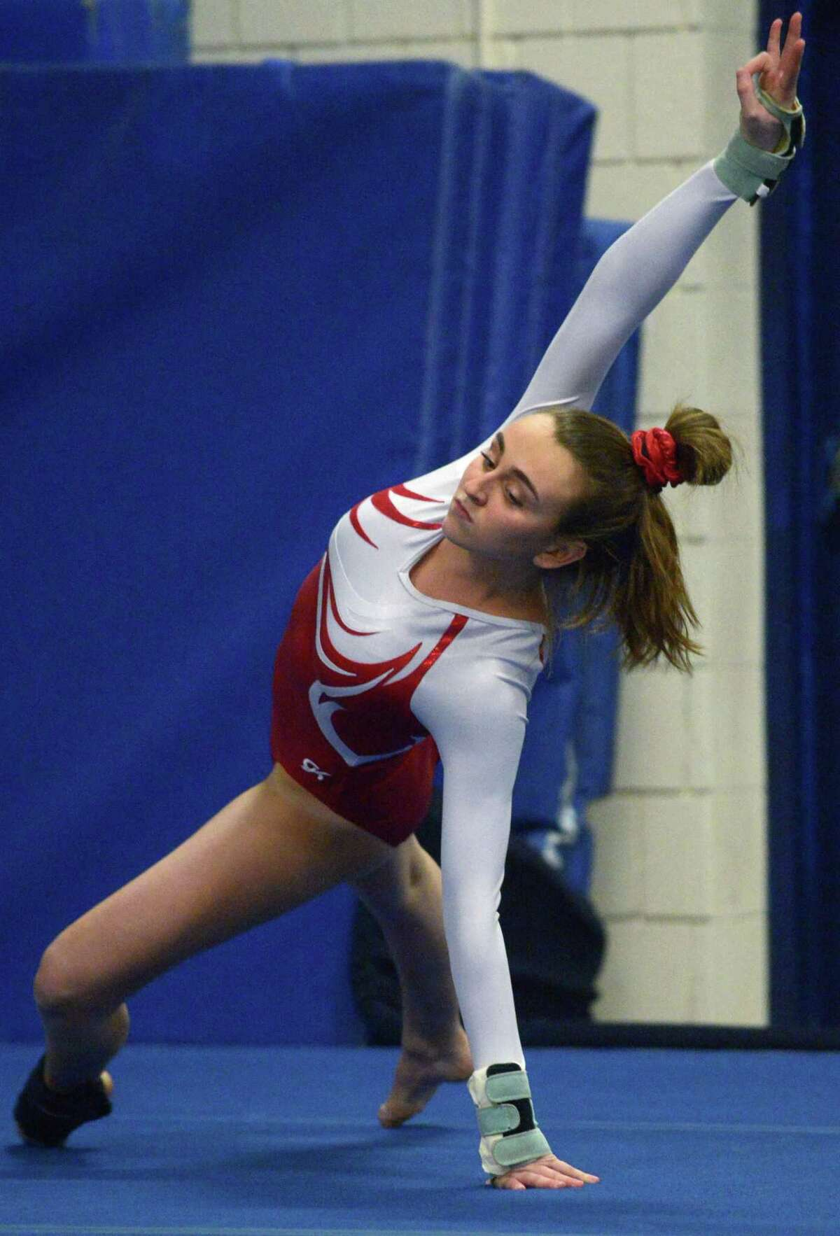Greenwich's Gianna Cardini, shown in a Jan. 4 meet, was first in the vault against Darien on Jan. 12.