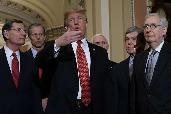WASHINGTON, DC - JANUARY 09:  U.S. President Donald Trump (3rd L) speaks to members of the media as (L-R) Sen. John Barrasso (R-WY), Sen. John Thune (R-SD), Vice President Mike Pence, Sen. Roy Blunt (R-MO) and Senate Majority Leader Sen. Mitch McConnell (R-KY) listen at the U.S. Capitol after the weekly Republican Senate policy luncheon January 09, 2019 in Washington, DC. Trump met with GOP lawmakers to shore up their resolve and support for his proposed border wall with Mexico as the partial federal government shutdown drags into a third week. (Photo by Alex Wong/Getty Images)