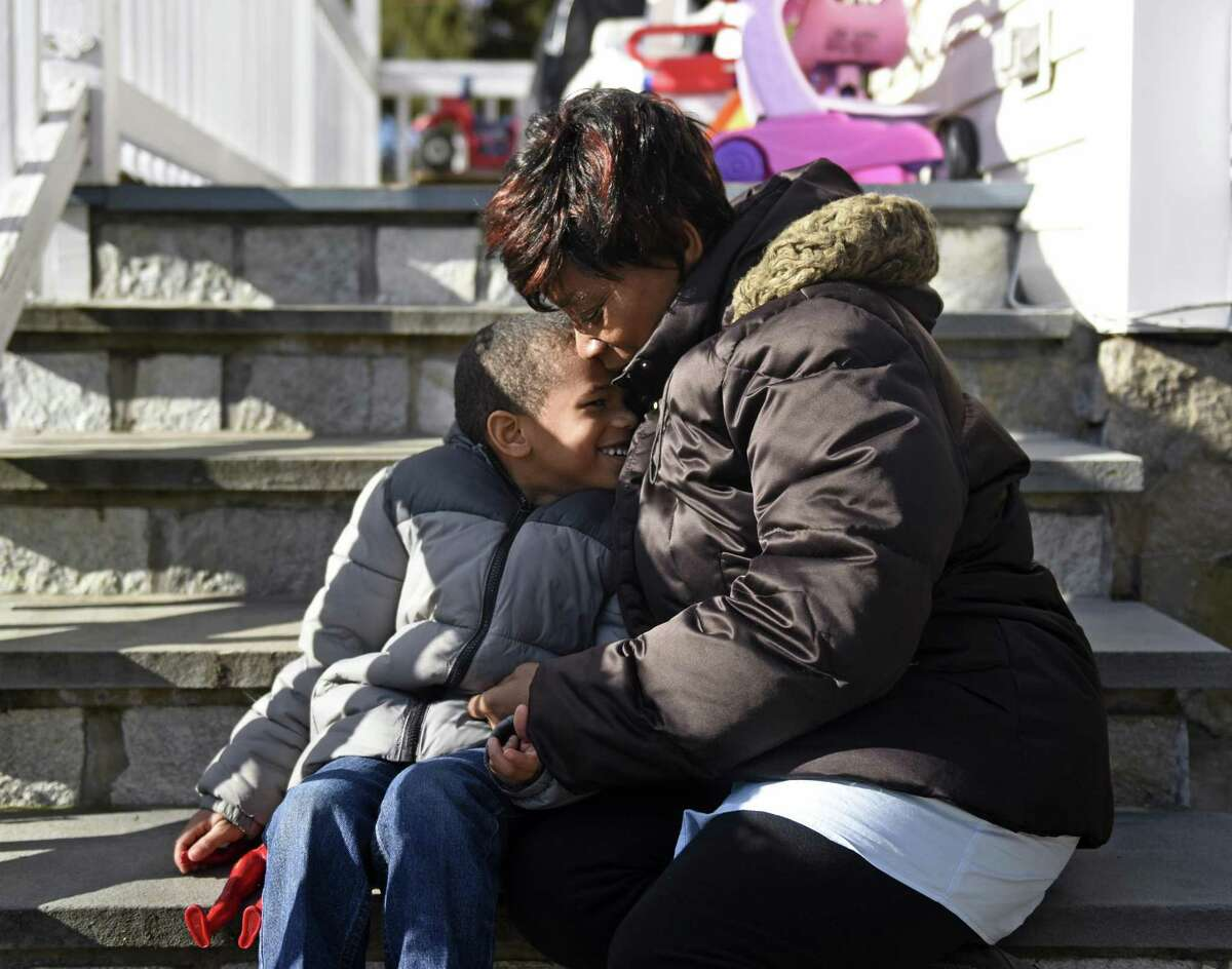 Tonya Gonsalves embraces her adopted child SeanMichael, 5, at their home in Westport on Monday. Gonsalves is SeanMichael's great aunt and adopted him in October 2015 after SeanMichael's mother experienced drug problems.