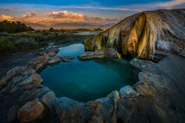 "1. The first slide in USA Today's gallery of the ""20 beautiful natural hot springs"" [https://www.usatoday.com/story/travel/experience/america/2018/01/26/20-beautiful-natural-hot-springs-cost-visit/1067313001/] is Travertine Hot Springs near Bridgeport, Calif."