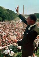 "This Aug. 28, 1963, file photo shows Dr. Martin Luther King Jr. acknowledging the crowd at the Lincoln Memorial for his ""I Have a Dream"" speech during the March on Washington. Monday marks the 55the anniversary of that event."