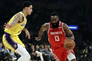 Houston Rockets' James Harden, right ,is defended by Los Angeles Lakers' Kyle Kuzma during the first half of an NBA basketball game Saturday, Oct. 20, 2018, in Los Angeles. (AP Photo/Marcio Jose Sanchez)