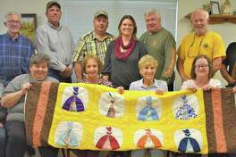 Pictured with the handmade quilt featured in the raffle drawing to be given away at the annual Leroy Miksch Senior Citizens Sunday Fun Day are, from left, front row: committee members Diane Cario, Cindy Valchar, Dorothy Stavinoha, Mary Agnes Miksch, Susan Wallis and Denise Sbrusch; back row: Larry Cario, Tim Sbrusch, Bub Krejci, the Rev. Mirjam Hass-Melchior of St. Paul?'s Presbyterian Church, Louis Teykl, Tom Wallis and Chairman Chris Janicek. The event begins at 10:30 a.m