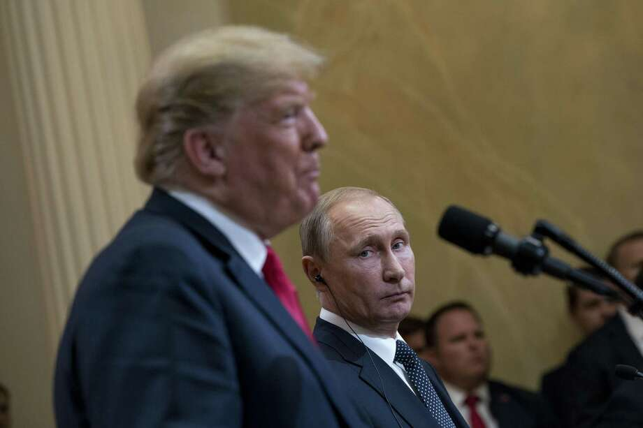 Despite President Donald Trump's seeming affinity for Russian President Vladimir Putin — shown together at a press conference in Helsinki, Finland, July 16 — there is no cause for the FBI to have undertaken an investigation into whether the president was a threat to national security. Photo: DOUG MILLS /NYT / NYTNS