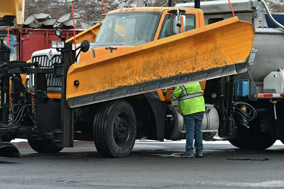 DOT employee Kim Couch adds a fuel additive to the newest plow in the fleet on Friday, Jan. 18, 2019 in Latham, N.Y. The Capital Region is expecting a major snow storm on Saturday night. (Lori Van Buren/Times Union)