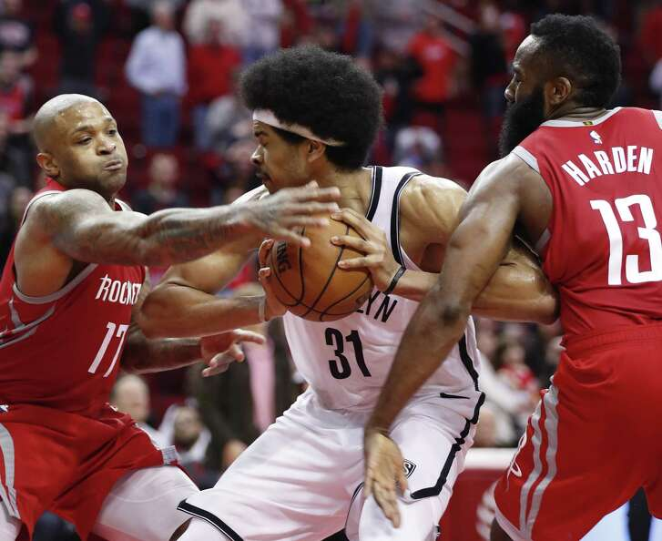 Brooklyn Nets center Jarrett Allen (31) grabs a rebound away from Houston Rockets forward PJ Tucker (17) and Houston Rockets guard James Harden (13) at the end of overtime, as the Nets took a come-from-behind 145-142 win, at Toyota Center on Wednesday, Jan. 16, 2019, in Houston.