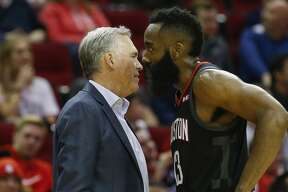 Houston Rockets head coach Mike D'Antoni talks to guard James Harden (13) during the second quarter of the NBA game against the Cleveland Cavaliers at Toyota Center on Friday, Jan. 11, 2019, in Houston.
