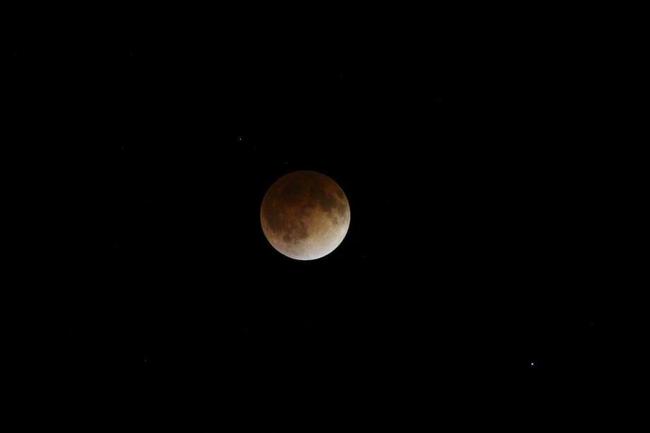 "A view of the ""blood moon"" total lunar eclipse on April 15, 2014. Photo: San Antonio Express-News File Photo / © 2014 San Antonio Express-News"