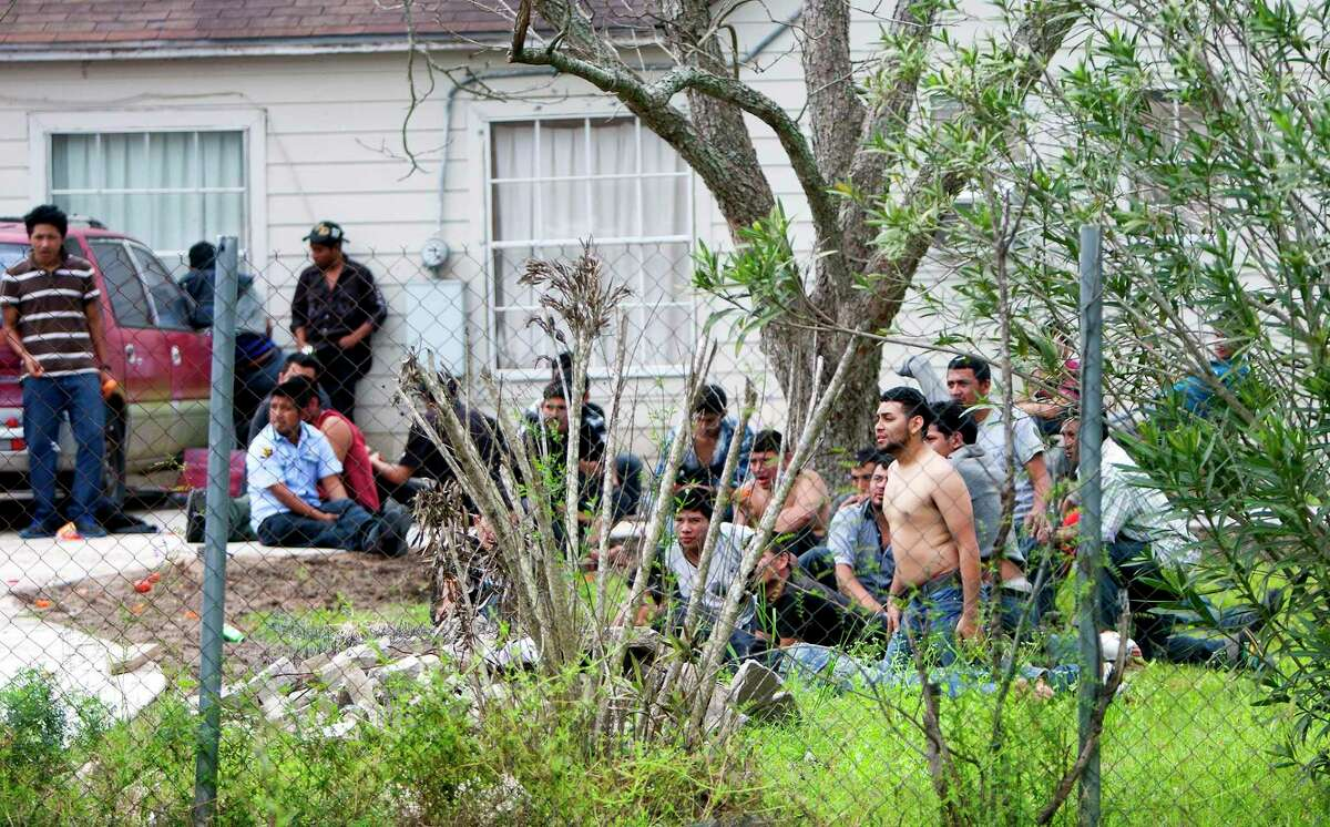 There have been 2,800 stash house raids in the Houston area in the past five years, including this 2014 raid at a home in Southeast Houston. Smugglers often keep their clients in squalid conditions and under armed guard - and in some cases they extort relatives for additional funds.