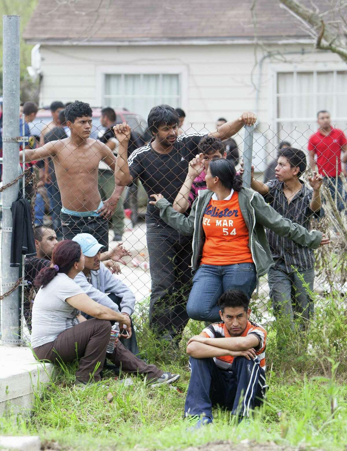 """More than 100 people were found inside a house at 14711 Almeda School Road in Southeast Houston, on March 19, 2014. Police found the group, who are all presumed to be in the country illegally -- at a squalid """"stash house"""" in southeast Houston. Police say it appears to be human smuggling operation."""