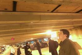 City Rep. Steven Kolenberg, R-16, inspects the plywood boards keeping cement from falling from the ceiling in the oldest portion of the Stamford Train Station Garage. Kolenberg took part in a Connecticut Commuter Rail Council tour of the garage on Wednesday, Jan. 16, 2019.