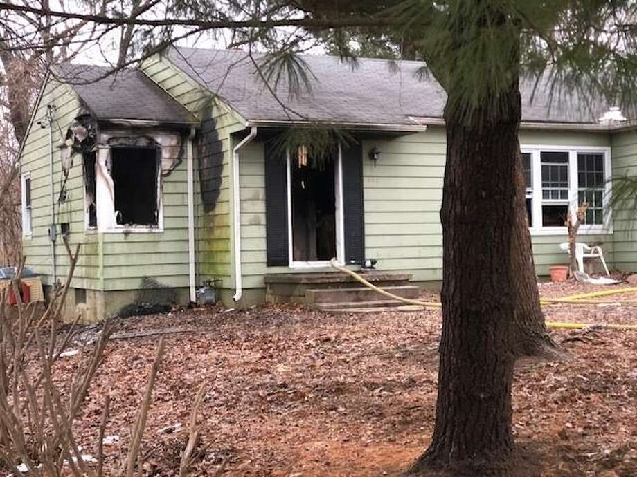 This house on Broadview Drive caught fire Friday afternoon. Edwardsville Fire Department crews worked to extinguish the fire, which is under investigation. Photo: Charles Bolinger | The Intelligencer