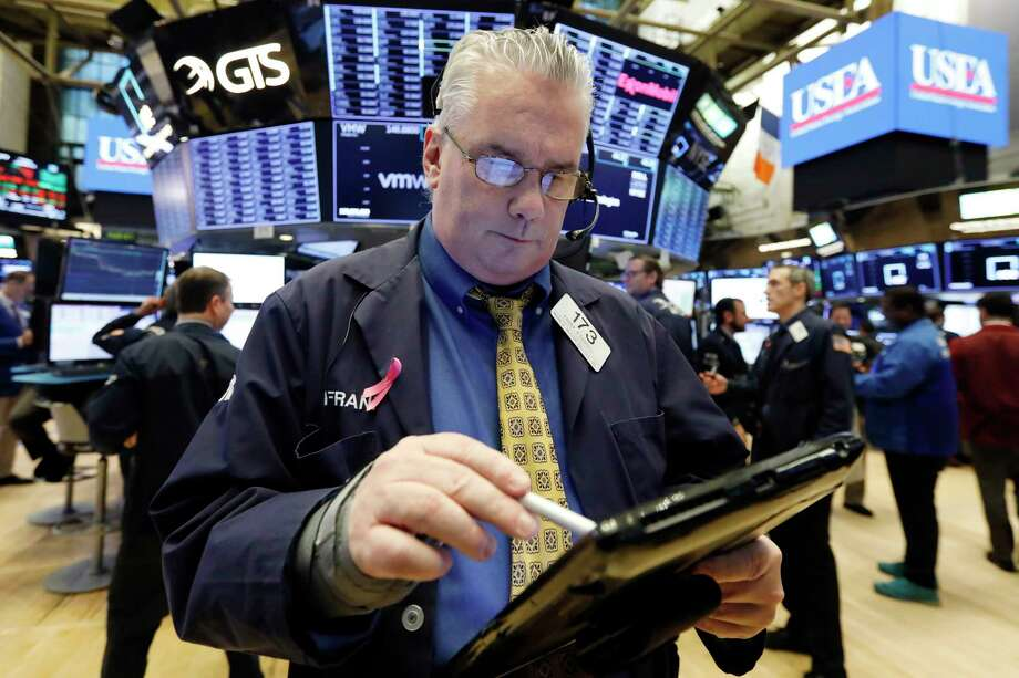 nullFILE- In this Jan. 11, 2019, file photo, trader Frank O'Connell on the floor of the New York Stock Exchange. The U.S. stock market opens at 9:30 a.m. EST on Friday, Jan. 18. (AP Photo/Richard Drew, File) Photo: Richard Drew / Copyright 2018 The Associated Press. All rights reserved