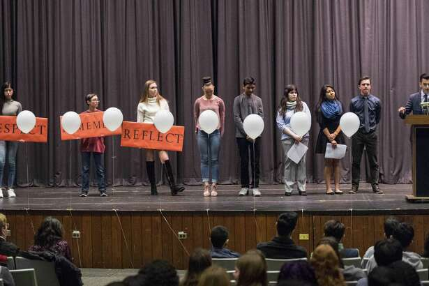 Seth Christofor, a senior at the Academy of Information Technology & Engineering, speaks to the audience during a walkout to honor the victims of the Parkland school shooting in the Rippowam Middle School auditorium. The poor lighting and sound systems in the venue have been criticized by users, leading to renters who use the venue to have to borrow their own systems. A project to improve the system has been in limbo for years, causing Board of Education members to ask when things will be fixed.