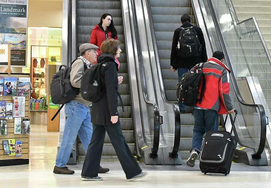 Travelers are seen at the Albany International Airport on Friday, Jan. 18, 2019 in Colonie, N.Y. (Lori Van Buren/Times Union) Photo: Lori Van Buren / 20045966A