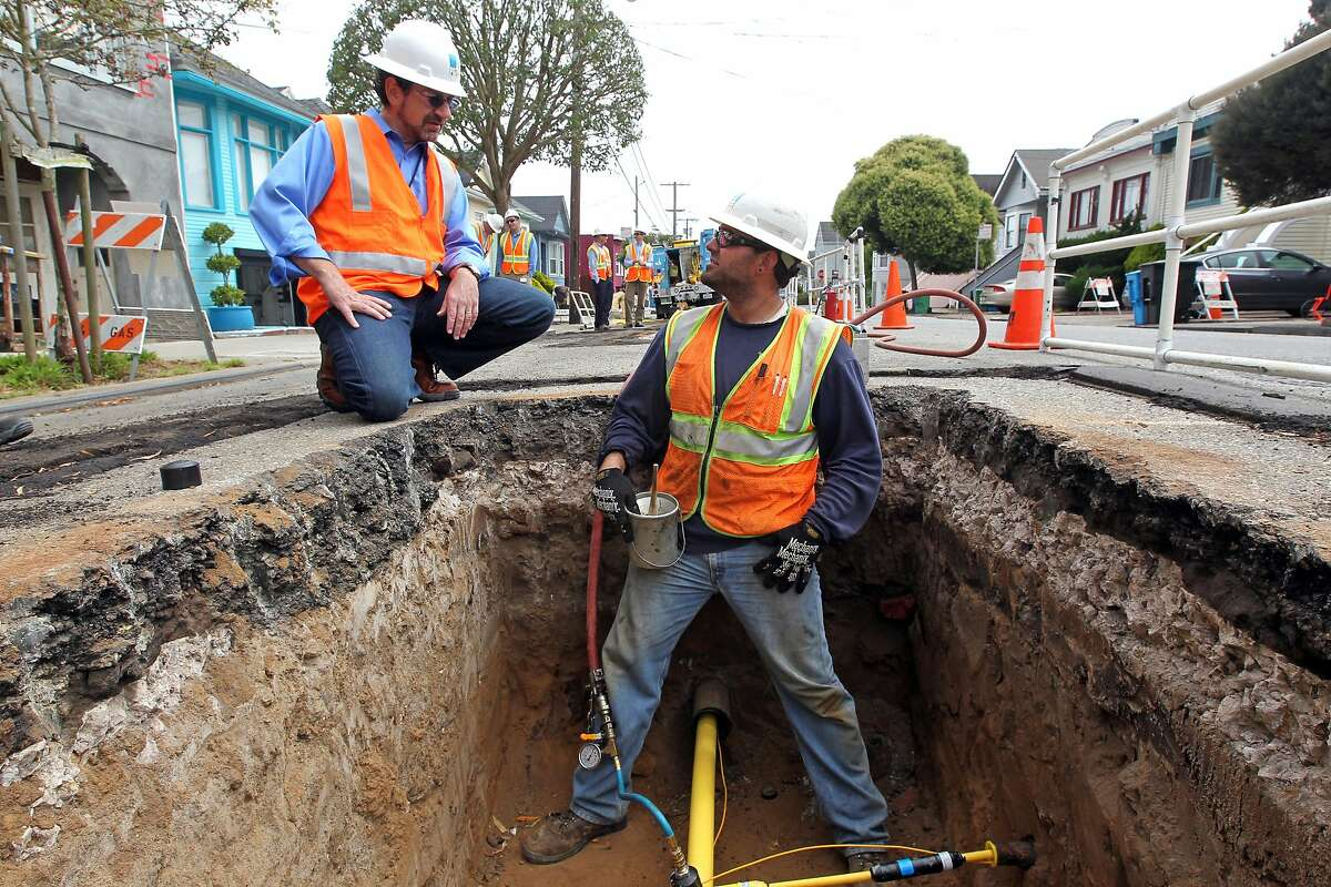 Nick Stavropoulos PG&E new executive hired to reorganizes its natural gas operations, talks with Brandon Guillen a member of a PG&E crew installing a new pipeline on Hearst Avenue in San Francisco Wednesday August 1, 2012.