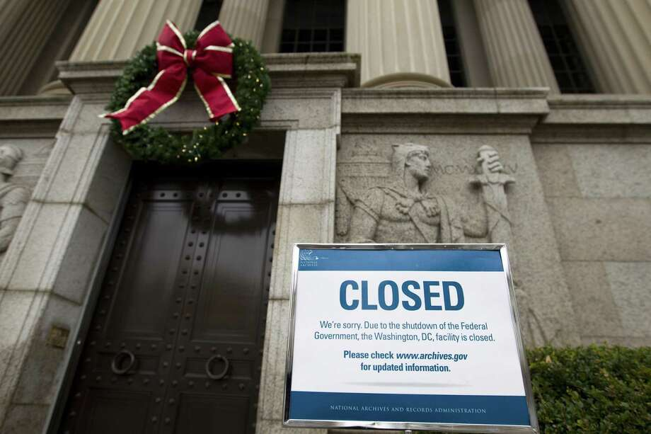 After nearly four weeks of the government being shuddered, Houston-area businesses are starting to feel the effects. And in some cases, those effects are becoming devastating, particularly to small businesses. Pictured, a closed sign is displayed at The National Archives entrance in Washington. (AP Photo/Jose Luis Magana) Photo: Jose Luis Magana, FRE / Associated Press / Copyright 2018 The Associated Press. All rights reserved