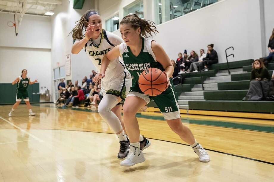 Sacred Heart's Sophia Curto dribbles past Choate's Chloe Blanc during their game on Friday at Sacred Heart Academy in Greenwich. Choate won 49-43. Photo: John McCreary / For Hearst Connecticut Media / Connecticut Post Freelance