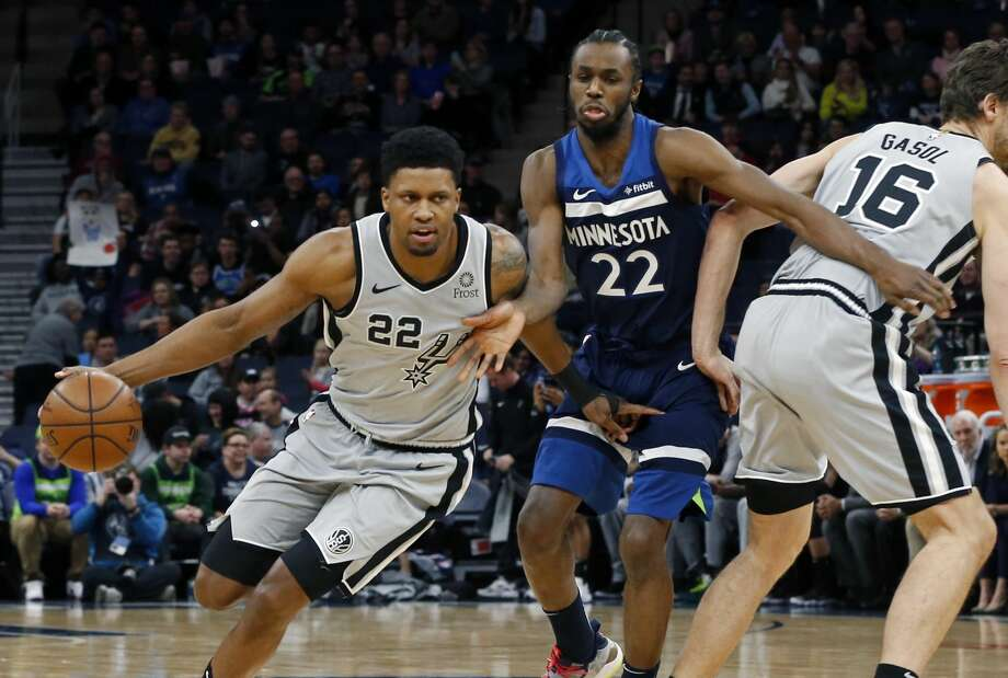 San Antonio Spurs' Rudy Gay, left, drives as Minnesota Timberwolves' Andrew Wiggins, center tries to get around Pau Gasol of Spain in the first half of an NBA basketball game Friday, Jan. 18, 2019, in Minneapolis. (AP Photo/Jim Mone) Photo: Jim Mone/Associated Press