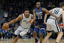 San Antonio Spurs' Rudy Gay, left, drives as Minnesota Timberwolves' Andrew Wiggins, center tries to get around Pau Gasol of Spain in the first half of an NBA basketball game Friday, Jan. 18, 2019, in Minneapolis. (AP Photo/Jim Mone)