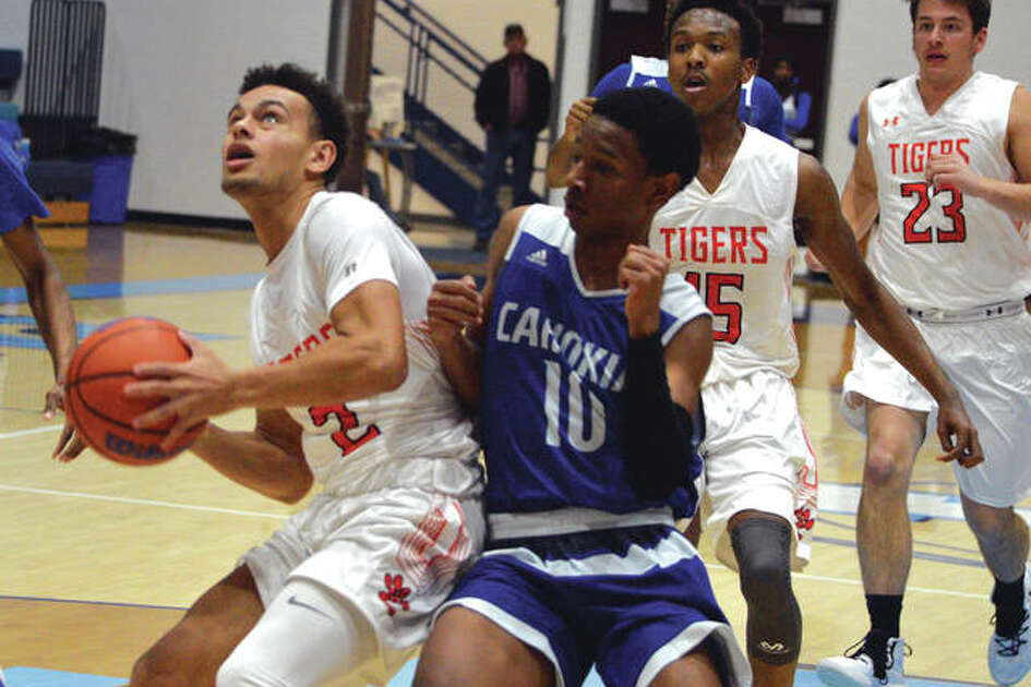 Edwardsville junior Ethan Young, left, goes up for a shot during the fourth quarter of Friday's game against Cahokia in the Jersey Mid-Winter Classic.