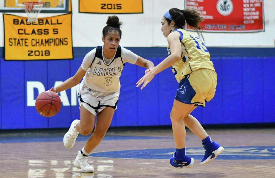 Erin Harris (3) of the Notre Dame Fairfield Lancers drives past a Newtown Nighthawks defender during a game played on Friday January 18, 2019 at Notre Dame Fairfield High School in Fairfield, Connecticut. Photo: Gregory Vasil / For Hearst Connecticut Media / Connecticut Post Freelance