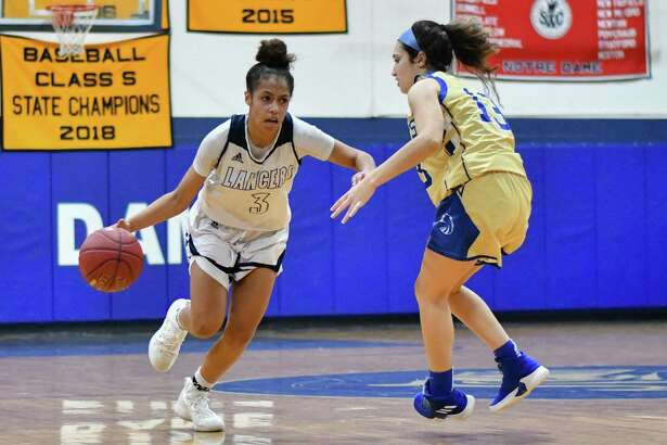 Erin Harris (3) of the Notre Dame Fairfield Lancers drives past a Newtown Nighthawks defender during a game played on Friday January 18, 2019 at Notre Dame Fairfield High School in Fairfield, Connecticut.