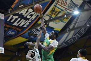 Patroons forward Stephen Cunningham jumps up toward the basket during a game against San Diego Friday, Jan. 18, 2019 at the Washington Avenue Armory Albany, N.Y. (Phoebe Sheehan/Times Union)