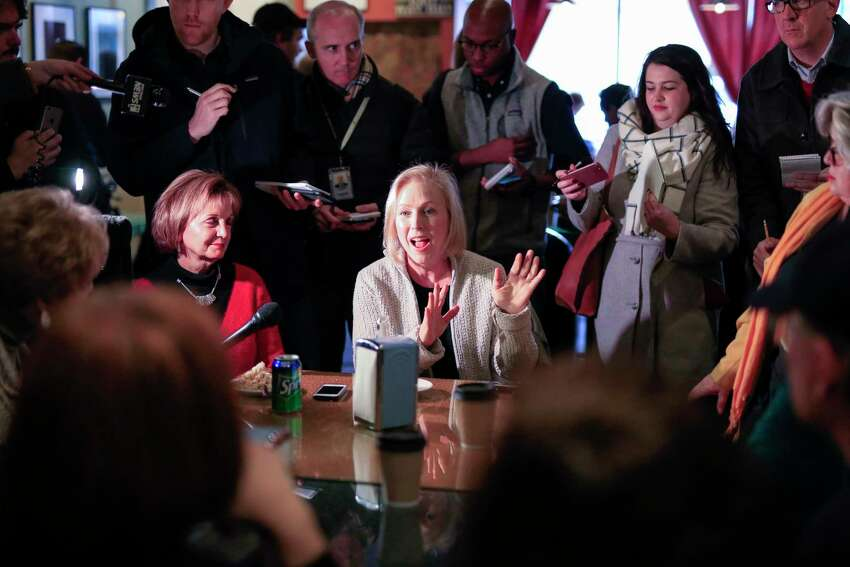 Senator Kirsten Gillibrand, D-N.Y., meets with residents at the Pierce Street Coffee Works cafe', in Sioux City, Iowa, Friday, Jan. 18, 2019. Sen. Gillibrand is on a weekend visit to Iowa, after announcing that she is forming an exploratory committee to run for President of the United States in 2020. (AP Photo/Nati Harnik)