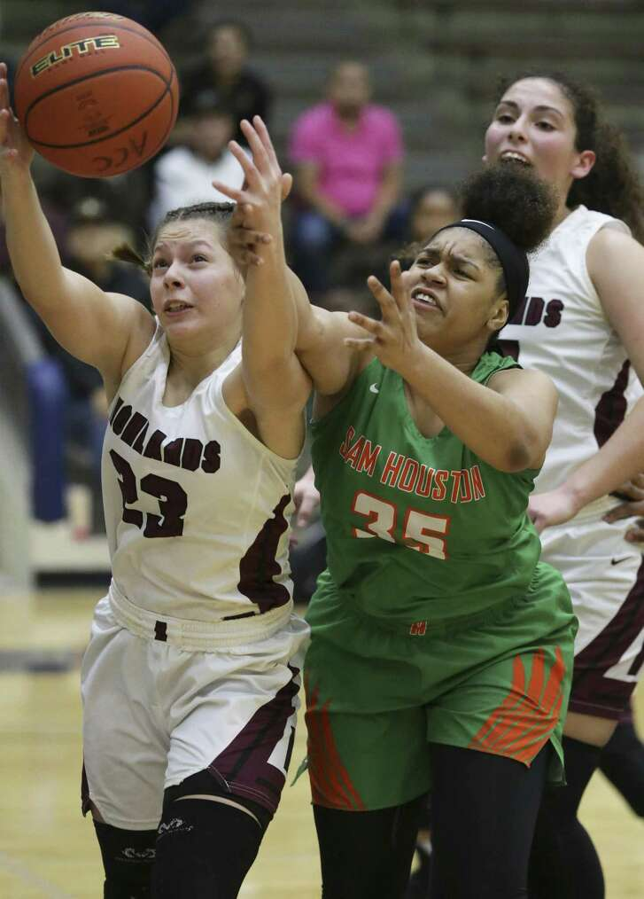Highlands' Layla Mendoza, left, wins a rebound battle with Sam Houston's Ta'Sharyana Chandler as Sam Houston plays Highlands in girls basketball at the Alamo Convocation Center on January 18, 2019.