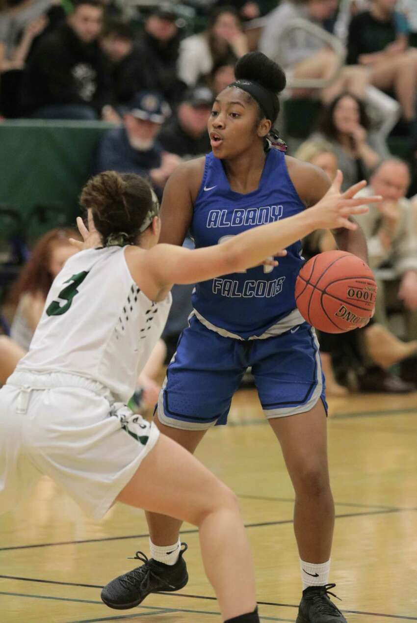 Albany's Ahniysha Jackson is guarded by Shen's Simone Walker during the girls' basketball matchup at Shenendehowa High School Friday, January 18, 2019. (Ed Burke photo-Special to the Times Union)