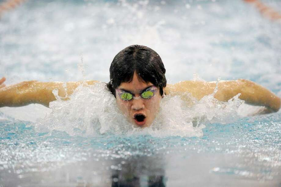 Greenwich's Michael Dustin swims the 100 butterfly during a dual meet  this past season. Photo: Keelin Daly / Greenwich Time
