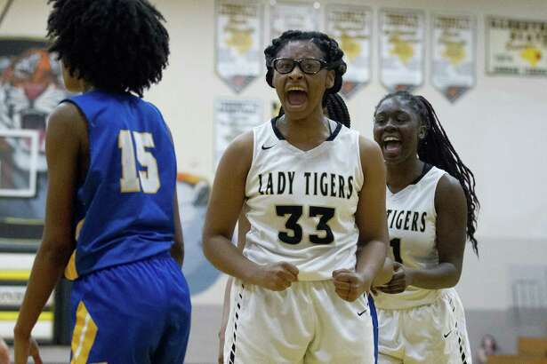 Conroe forward Jade Traylor (33) reacts after making a basket and drawing a foul during the third quarter.