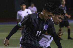 Jorge Perez of Willis (11) dribbles around Miguel Puente of Porter (20) during a District 20-5A boys soccer game Friday, Jan. 18, 2019 at Berton A. Yates Stadium in Willis.