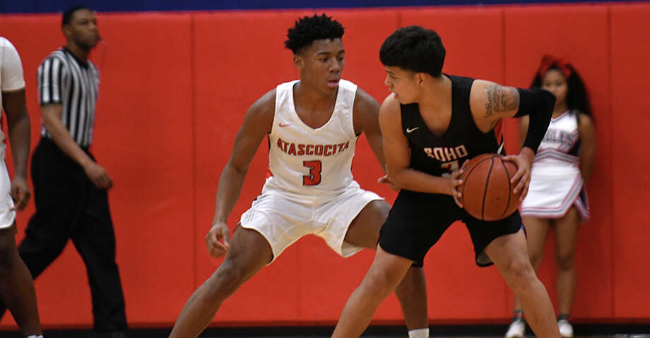South Houston senior Jido Hinojosa, right, works the ball against Atascocita sophomore point guard Tom Hart (3) during their District 22-6A matchup at AHS on Dec. 11, 2018. Photo: Jerry Baker/Contributor