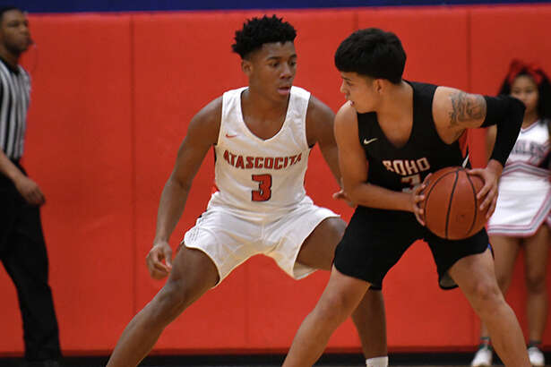 South Houston senior Jido Hinojosa, right, works the ball against Atascocita sophomore point guard Tom Hart (3) during their District 22-6A matchup at AHS on Dec. 11, 2018.