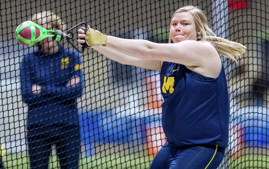 Kayla Deering participates in the weight throw for the University of Michigan. The former Elkton-Pigeon-Bay Port standout returned from injury in a big way last week, as she broke the school record in the event. (Photo courtesy of Michigan Athletics)