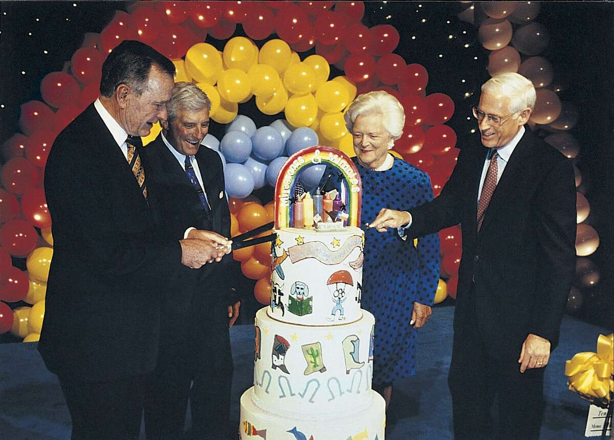 Dr. John Mendelsohn (right) helps cut the birthday cake for former President George H.W. Bush and wife Barbara Bush, along with fundraiser Robert Mosbacher Sr. (second from left), at the MD Anderson Cancer Center in 1999.