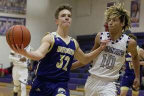 FILE PHOTO - Montgomery guard Elijah Schleicher (32) gets past Willis guard Davonte Nephew (10) during the second quarter of a District 20-5A high school basketball game at Willis High School, Tuesday, Dec. 11, 2018, in Willis.
