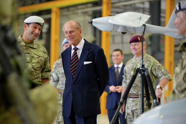 WATTISHAM, ENGLAND - OCTOBER 9: (NO ARCHIVE; NO SALES; EDITORIAL USE ONLY) In this photo provided by the MoD, HRH Prince Phillip being is shown a Desert Hawk unmanned ariel system by Major Steve Bharat (COR) October 9, 2014 at Wattisham Airfield in Wattisham, England. Prince Philip visited the unit at Wattisham Flying Station in his capacity as Colonel-in-Chief of the Royal Electrical and Mechanical Engineers. The unit is responsible for maintaining the Army's helicopters and unmanned aerial vehicles, with 8 Field (Para) Company, based in Colchester, looking after the trucks and armoured vehicles of 16 Air Assault Brigade. Prince Philip was shown the vehicles the troops work on, ranging from the Apache attack helicopter - which 7 Air Asslt Bn REME troops are currently supporting on operations in Afghanistan - to the Watchkeeper unmanned air system and Foxhound protected patrol vehicle, representing the next generation of Army equipment. Another cutting edge vehicle involved in the day was the Bloodhound Super Sonic Car project, which aims to reach a record breaking 1,000 mph. The British Army is supporting Bloodhound, bringing the technical training and operational experience of REME soldiers to help drive the project towards its three aims of breaking the world land speed record; developing new technologies; and inspiring the country's next generation of scientists, technicians, engineers and mathematicians. (Photo by Corporal Andy Reddy RLC/MoD via Getty Images)