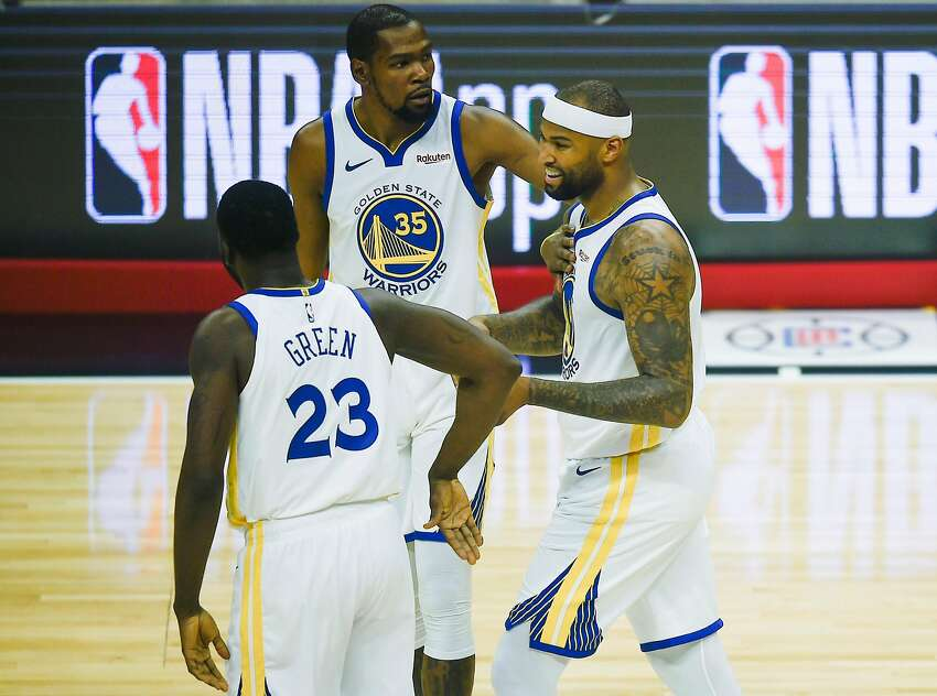 Golden State Warriors center DeMarcus Cousins, right, celebrates with forward Kevin Durant, during a game on Jan. 18.