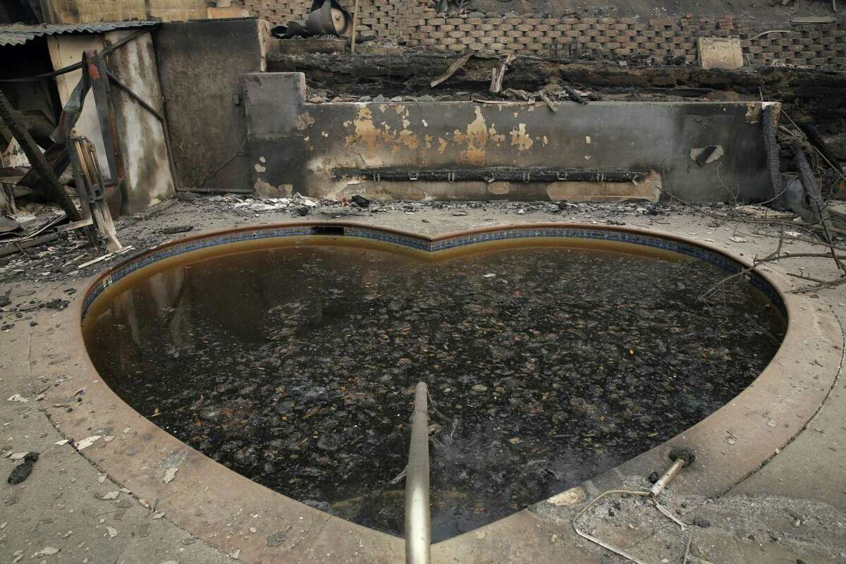 Destruction surrounds a heart-shaped pool at Harbin Hot Springs after fire blasted through the area near Middletown in 2015.