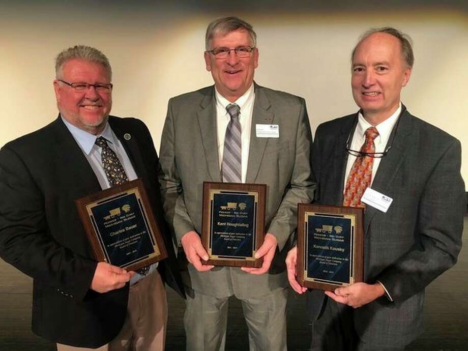 Outgoing directors honored Thursday, Jan. 10, at Michigan Sugar Co.'s annual meeting are, from left, Vice Chairman Charlie Bauer, Kent Houghtaling and Outside Director Ken Kousky. (Photo provided)