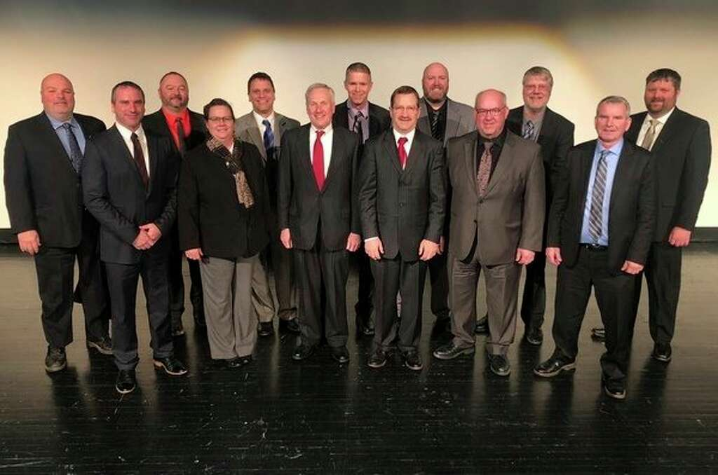 The Michigan Sugar Co. Board of Directors gathers during the company's Annual Meeting held Thursday, Jan. 10 at Saginaw Valley State University. They are, from left: Back row - Mark Richards, Bill Meylan, Clark